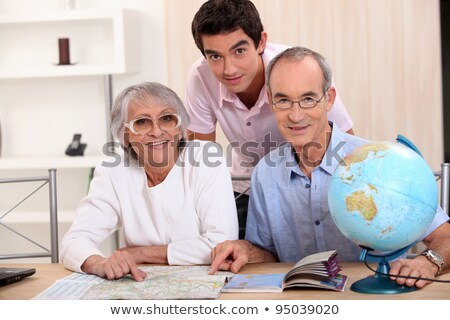 Young man and senior couple seeking a route on a map Stock photo © photography33