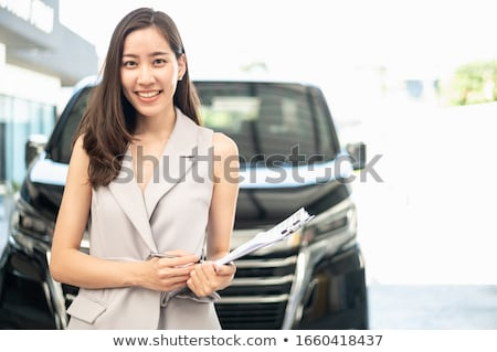 Car salesman with female customer Stock photo © photography33