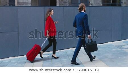Empresária caminhada café mala negócio moda Foto stock © wavebreak_media