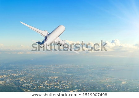 aircraft flying over the clouds Stock photo © meinzahn