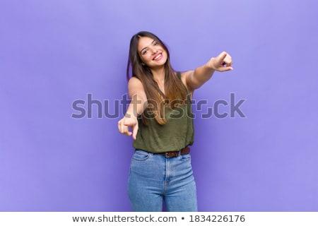 Fiatal nő mutat kamera mindkettő kezek fiatal felnőtt Stock fotó © bmonteny