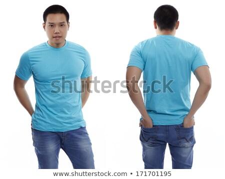 Man posing with blank light blue shirt Stock photo © sumners