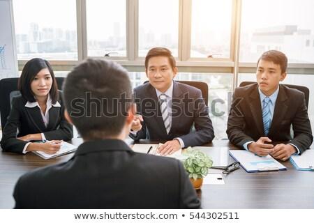 sério · empresário · falante · telefone · trabalhando · escritório - foto stock © kzenon