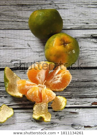 Fresh Sweet Orange Fruit and Peel on Rustic Wood Background Stock photo © stevanovicigor