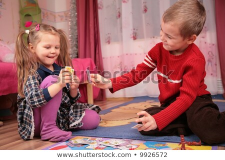 two children play cards in playroom stock photo © Paha_L