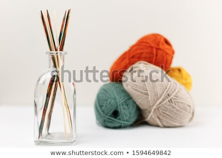 Stockfoto: Green And Yellow Balls Of Yarn For Knitting With Spokes On A White Background