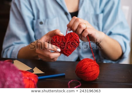 Closeup on red heart made from wool in hand of woman Stock photo © vlad_star