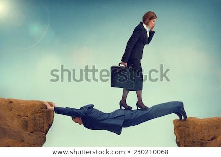 üzlet üzletember rejtőzködik fegyver terv körül Stock fotó © ra2studio