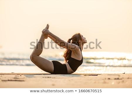 Vrouw boeg mediteren zonsondergang zen Stockfoto © photocreo