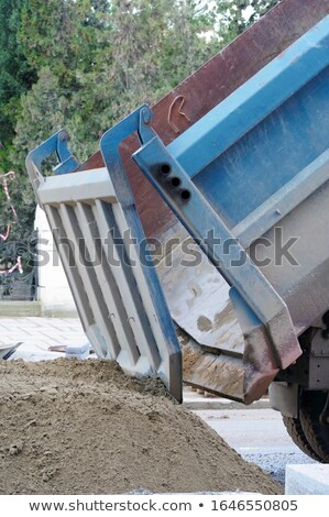 Dumptruck in action on a construction site Stock photo © Nobilior