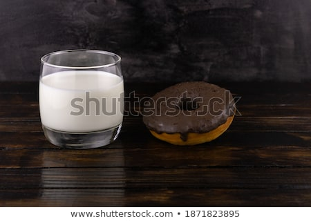 Chocolate donut with glass close up stock photo © Sibstock