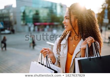 Fashion Image young woman in a stylish black dress Stock photo © julenochek