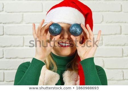 man holding a toy ball in front of eye Stock photo © IS2