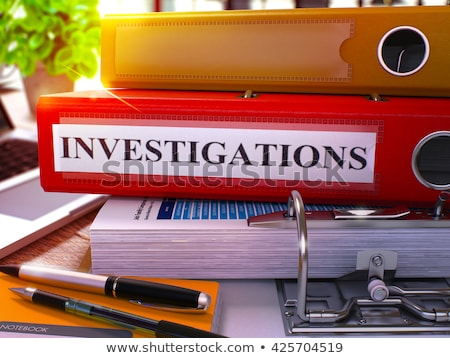 Red Ring Binder with Inscription Investigations. Stock photo © tashatuvango