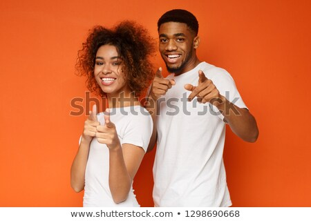 young couple pointing fingers at camera stock photo © feedough