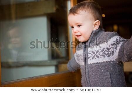 Young boy in chalet doorway Stock photo © IS2