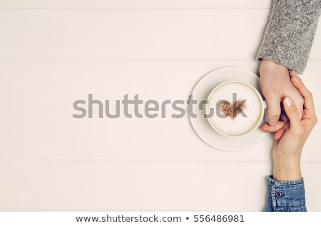 female hands photographing a coffee cup stock photo © wavebreak_media