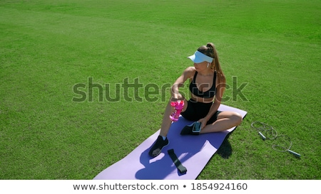 pretty young woman having a break during exercise stock photo © boggy