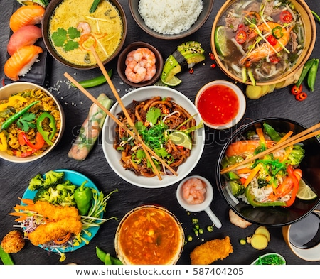 Stock photo: Chinese food set on stone table