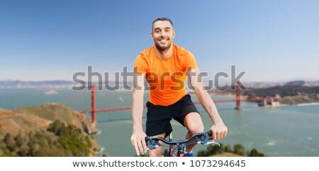 Feliz homem equitação bicicleta Golden Gate Bridge fitness Foto stock © dolgachov