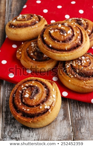 Sweet cinnamon bun on wooden table Stock photo © furmanphoto