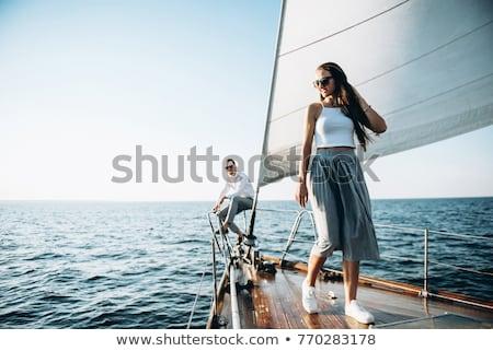 Atrakcyjna kobieta żeglarstwo luksusowe jacht liny Zdjęcia stock © boggy