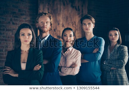 Close-up of confident businessman with folded hands. Stock photo © lichtmeister