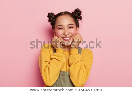 Portrait of smiling joyous girl with hands at chin. Stock photo © lichtmeister