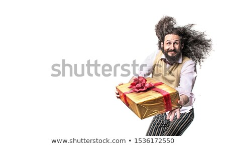 Nerdy guy holding a packed gift - isolated Stock photo © majdansky
