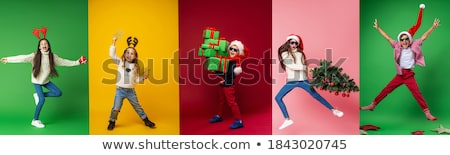 children and Santa Claus on multicolor background. Stock photo © choreograph