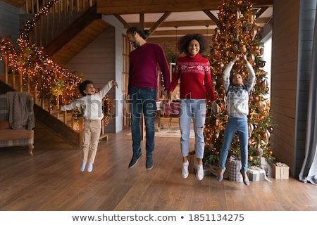 people dance together and celebrate winter holiday stock photo © robuart