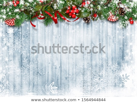 Festive Christmas or New Year Background. Christmas firtree branches with confetti. Holiday's Backgr Stock photo © olehsvetiukha
