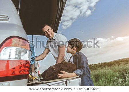 Family vacation lifestyle. Happy father and son stand at viewpoint. Look at beautiful beach under hi Stock photo © galitskaya