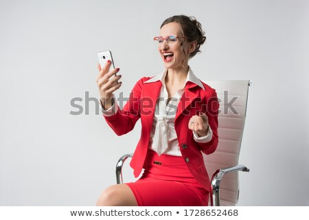 Businesswoman having great success just getting message Stock photo © Kzenon
