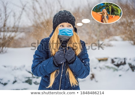 Woman dreams about summer vacation. The woman was very froze in winter under snowfall BANNER, LONG F Stock photo © galitskaya