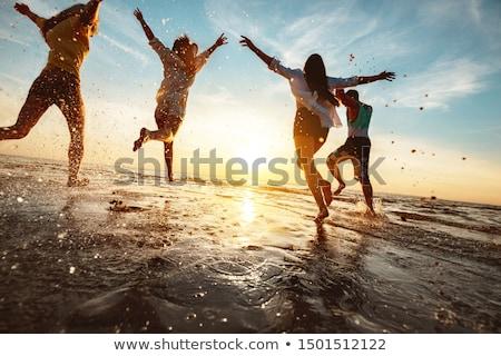 Stok fotoğraf: Gençler · plaj · bilgisayar · güneş · bikini · hareketli