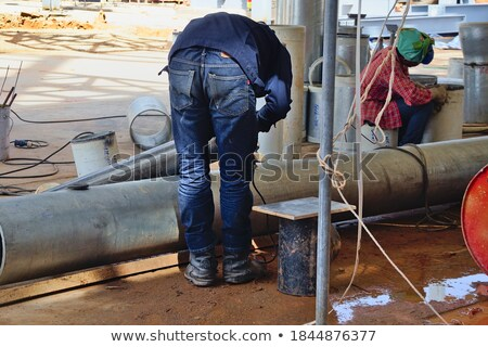 Contractor bending pipe with tool Stock photo © photography33
