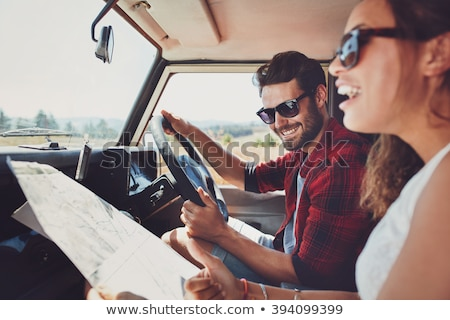 young couple looking at a map stock photo © photography33