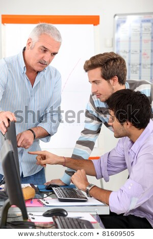 Teacher and students gathered around computer screen Stock photo © photography33