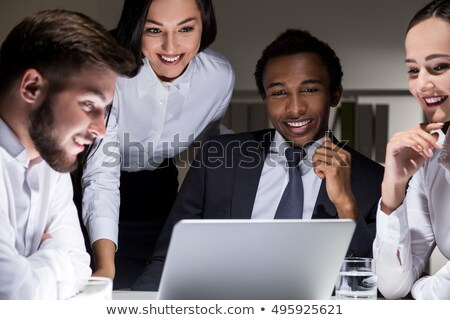 Four colleagues gathered around laptop Stock photo © photography33
