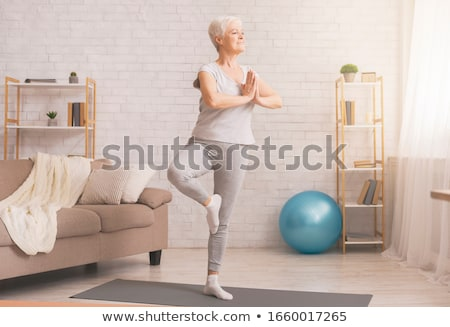 Senior Yoga - Flexible Stock photo © lisafx