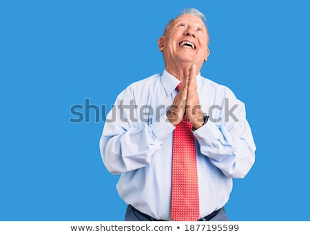 Grey haired businessman begging Stock photo © photography33