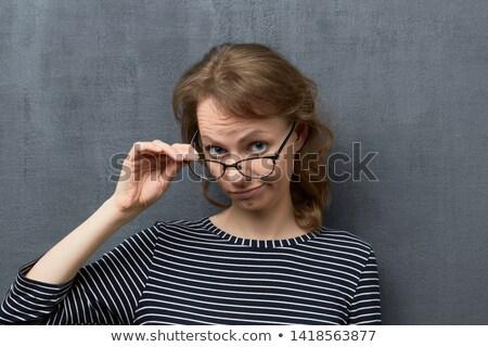 figyelmes · fiatal · üzletasszony · tart · szemüveg · fehér - stock fotó © wavebreak_media