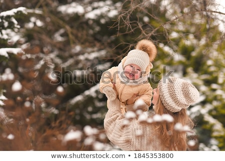 Happy woman with her daughter in winter time Stock photo © emese73