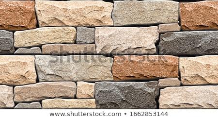 Muro di pietra piastrelle casa muro urbana wallpaper Foto d'archivio © scenery1