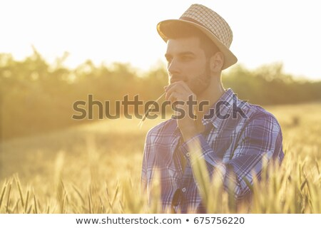casual man with straw in mouth at sunset stock photo © feedough