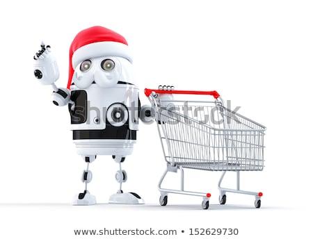 robot santa with shopping cart pointing at object stock photo © kirill_m
