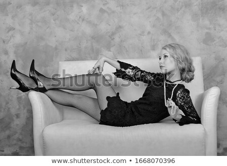 Sepia portrait of an elegant woman on a couch Stock photo © Nejron