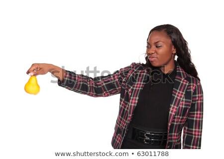 Pear disgust - African American businesswoman Stock photo © dgilder
