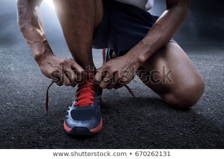 Runner man closeup - male athlete running on road Stock photo © Maridav